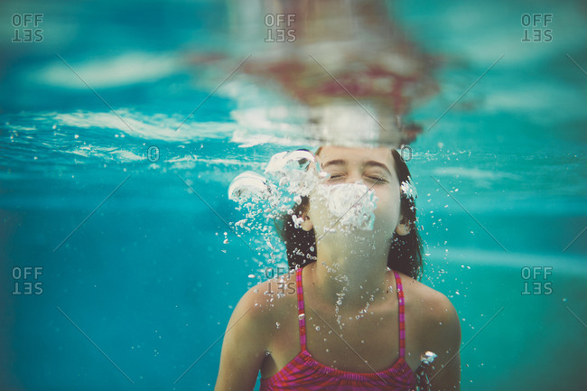 Girl blowing air underwater