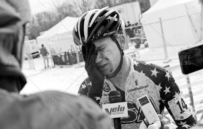 Louisville, KY - February 2, 2013: Cyclocross racer giving interviews after race