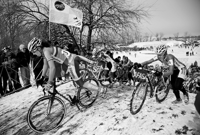 Louisville, KY - February 2, 2013: Cyclocross racers reaching top of a hill