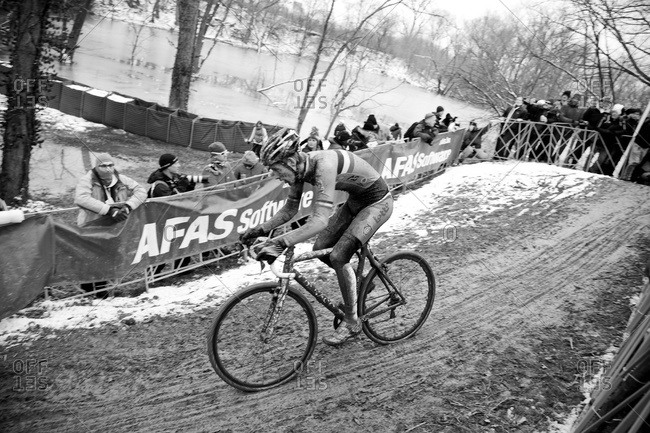 Louisville, KY - February 2, 2013: Cyclocross racer going down muddy hill