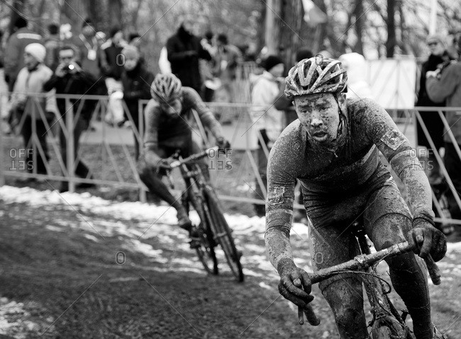 Louisville, KY - February 2, 2013: racers on Cyclocross course going along muddy curve