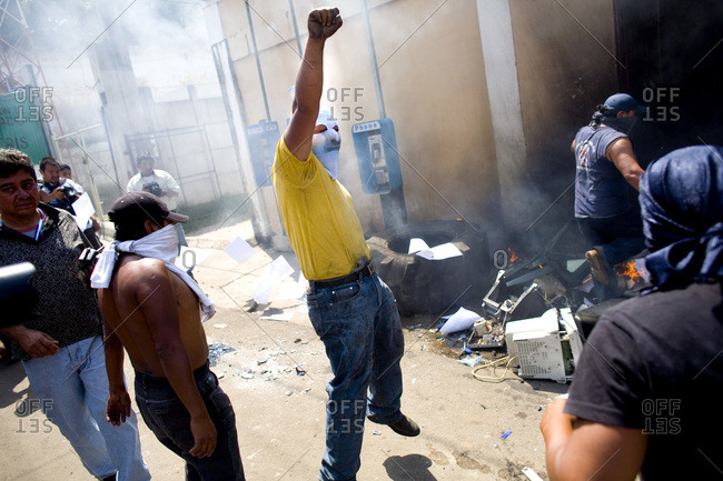 Palin, Guatemala - September 11, 2007: Masked man celebrating destruction of mayor's office in Palin, Guatemala