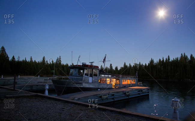Boat docked along shore in  Isle Royale National Park