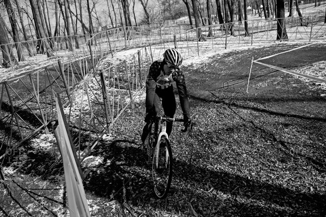 Louisville, KY - February 1, 2013: Cyclocross racer practices on course
