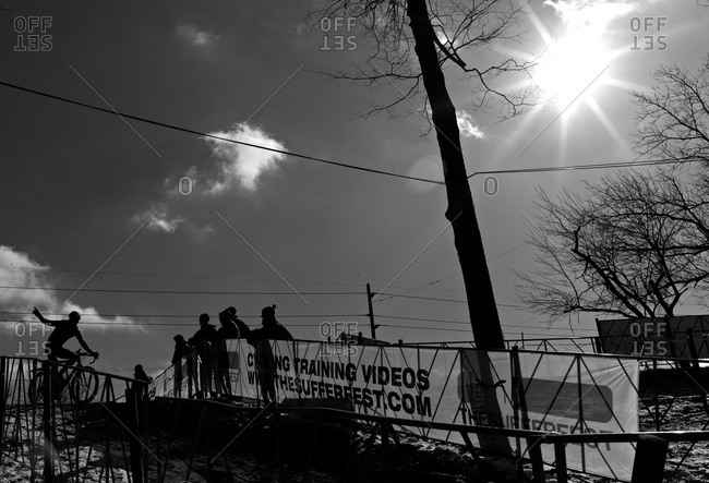 Louisville, KY - February 1, 2013: Cyclocross racer and observers on empty course