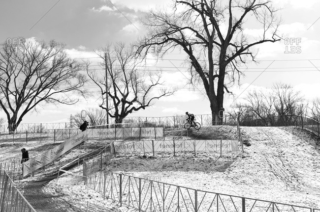 Louisville, KY - February 1, 2013: Cyclocross racer practicing on snowy course