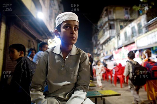 Mumbai, India - November 19, 2006: A boy in Muslim garb in Mumbai street