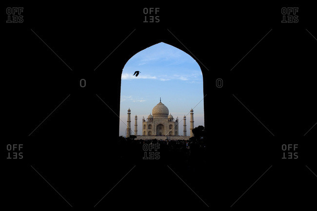 The Taj Mahal seen through archway