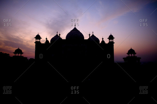 Taj Mahal silhouetted by sunset