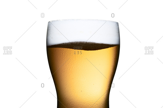 Foam tops a glass of freshly poured beer