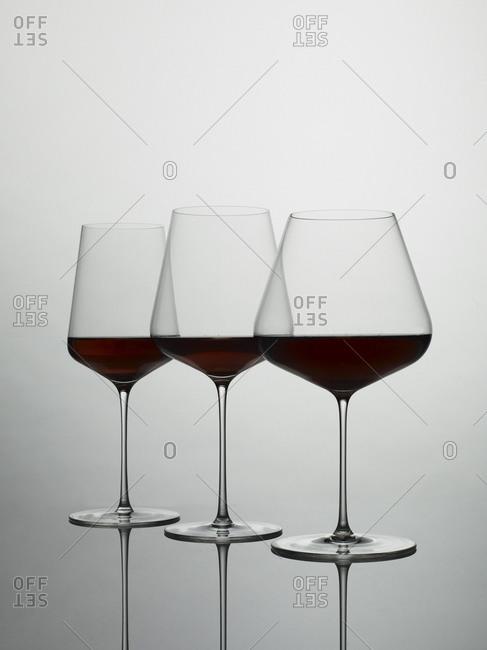 Wine fills three glasses of various sizes