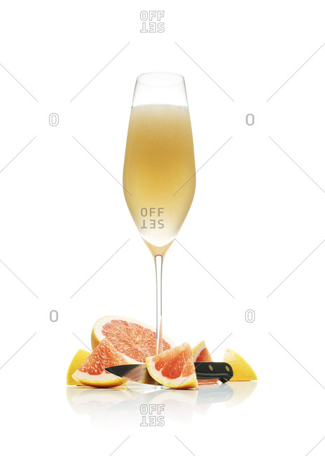 Grapefruit mimosa served in a champagne glass