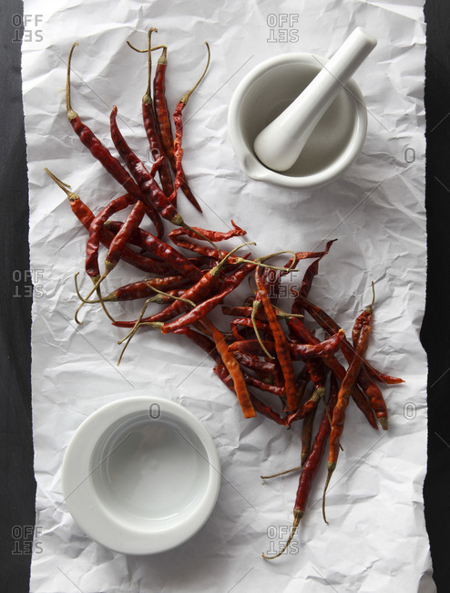 Dried chili peppers on a piece of paper
