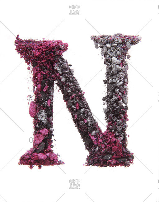 Makeup powder forms the letter N