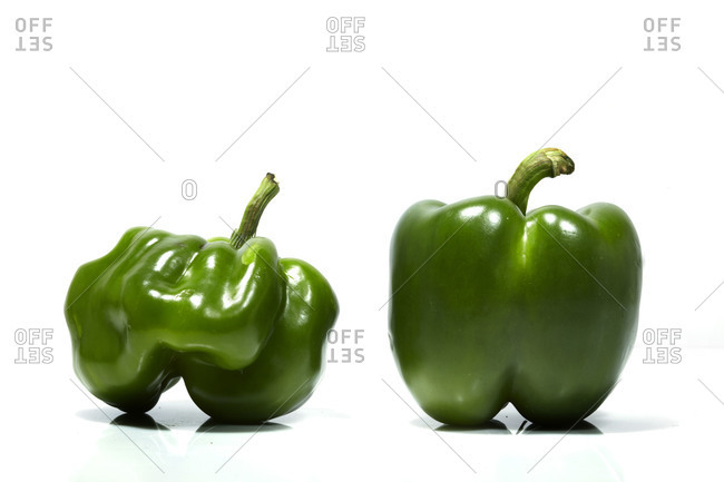 Two peppers side by side