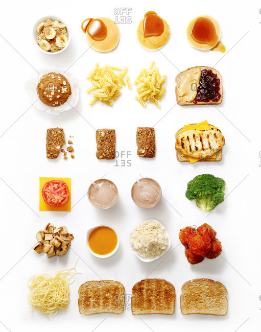 Rows food arranged on a white background
