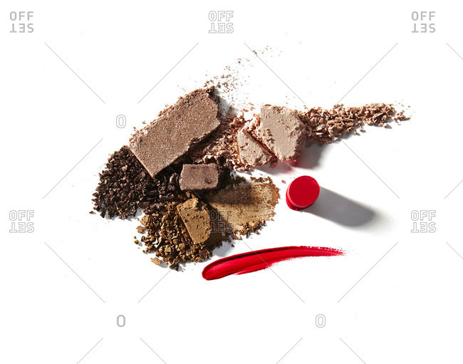 A variety of makeup against a white background