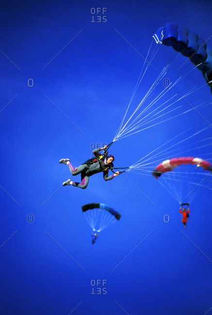 Skydiver with small group in air, California, USA