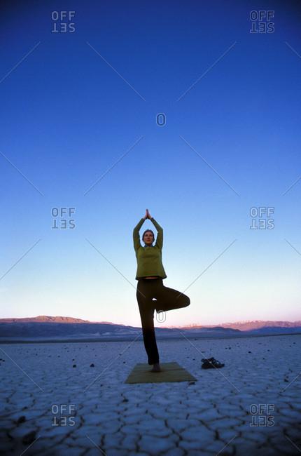 Woman doing yoga outdoors - Offset
