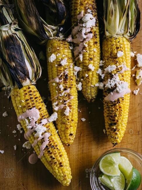 Mexican style grilled corns with cheese and lime