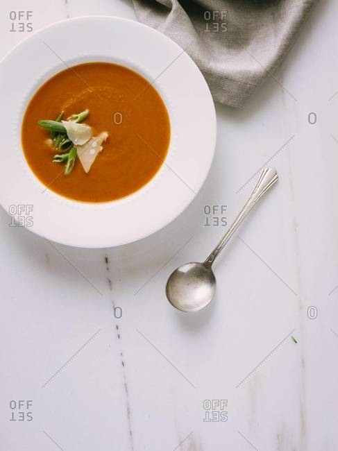 Creamy tomato soup served on a table