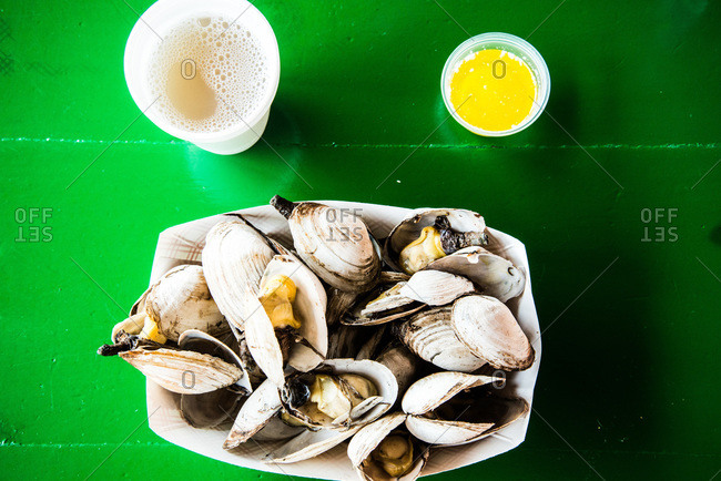 Steamed clams on green table