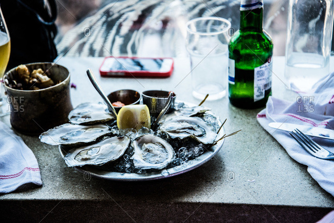 Served oysters on a granite table