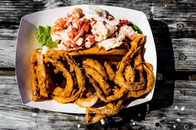 Onion rings with lobster served on a table