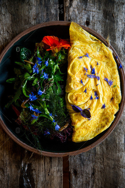 Omelet with salad served on a table