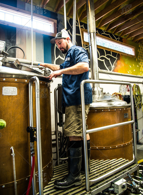 Maine, USA -  August 2013: Man working in a brewery