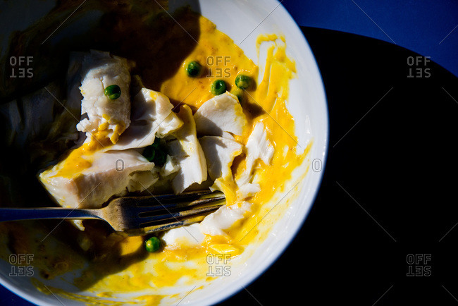 Close up of halibut fillet with pumpkin puree and peas