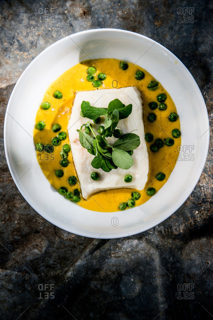 Halibut fillet with pumpkin puree and peas