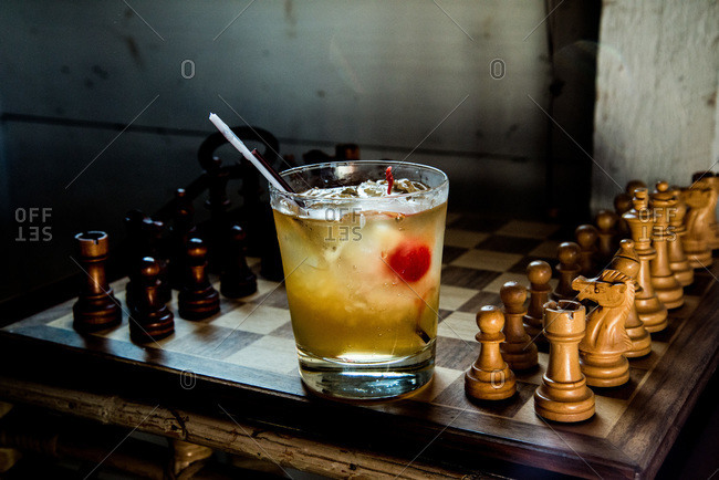 Close up of a cocktail on a chessboard