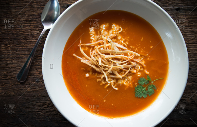 Tomato soup with tortilla strips and cheese