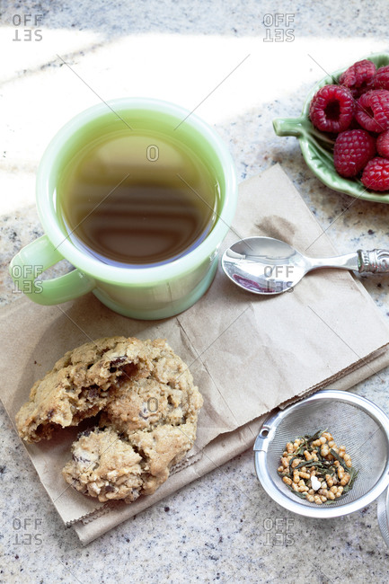 Afternoon tea with cookies and raspberries