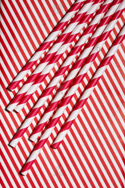 Striped straws on striped background
