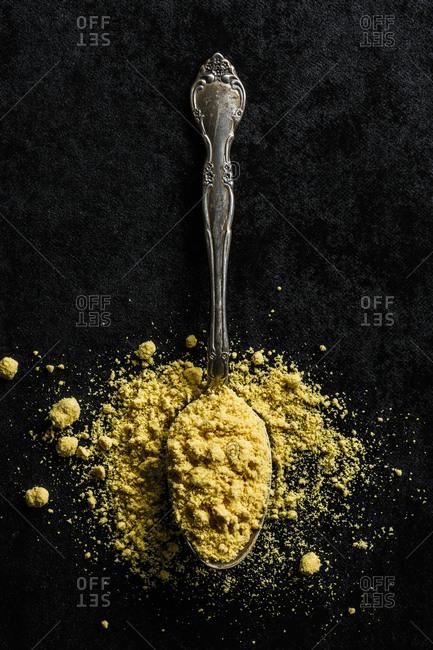 Mustard powder on a spoon
