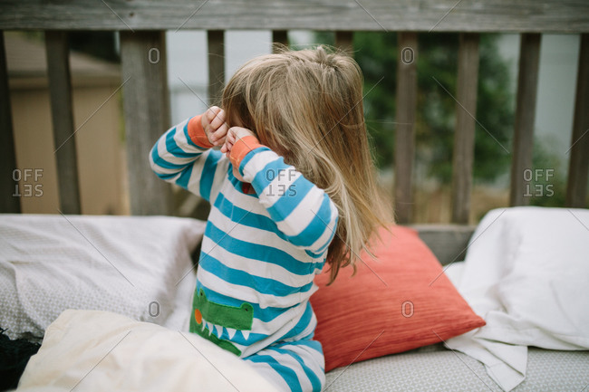 Girl waking up from nap on porch