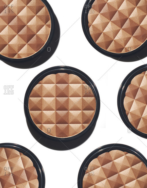 Six compacts with powder foundation on white background