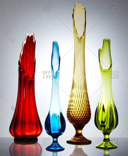 Four tapered vases backlit in studio shot