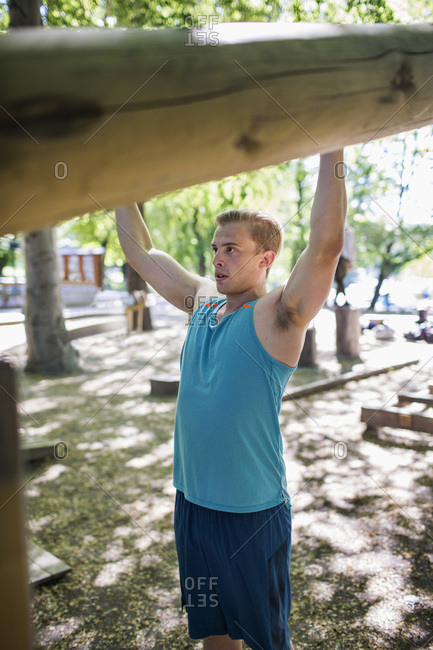 Determined man exercising at outdoor health club