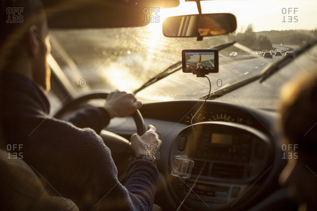 Man driving car while using GPS by daughter