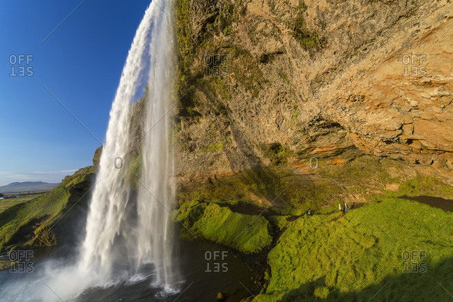 Cliff overhang and Seljalandsfoss waterfall in Iceland