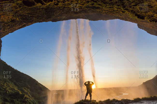 Man behind Seljalandsfoss waterfall in Iceland