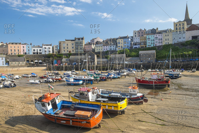 Harbour, Tenby, Pembrokshire, West Wales, Wales, UK - July 7, 2014: Boats grounded in harbor in West Wales