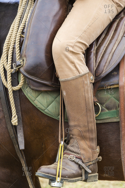 Close up of an Italian cowboy's boot in stirrup on horse