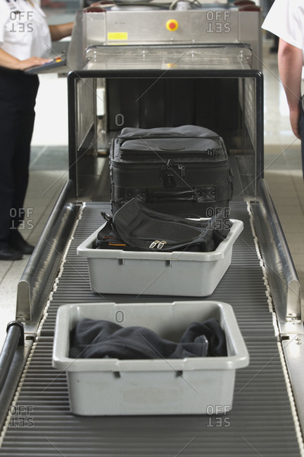 Airport security worker checking baggage
