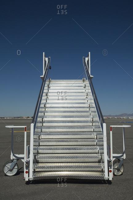 Airplane staircase on tarmac - Offset