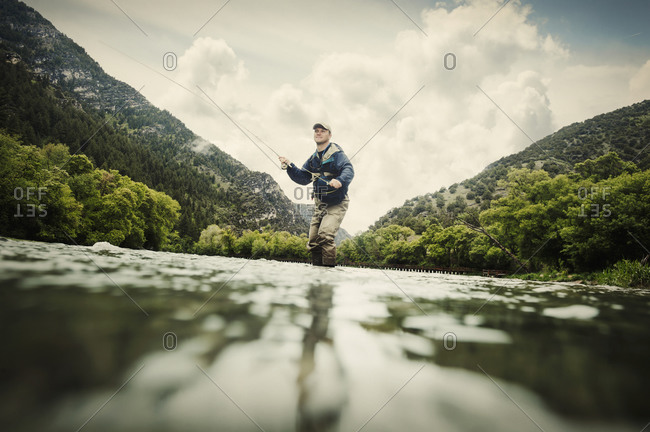 Fly fisherman, low angle view