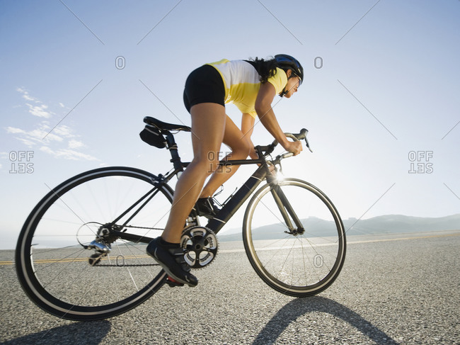 Female cyclist , low angle view